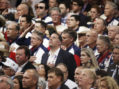 Texas delegates to the Republican National Convention hold their hands over their hearts for the U.S. National Anthem at the start of the at the Republican National Convention in Cleveland
